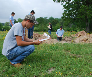 Students mark their score sheets at one of four sites used during the Area 9 land judging contest.
