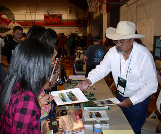 Gary Fuentes, NRCS district conservationist, informs students about the career opportunities available through the agency at the annual Van Horn Career Day.
