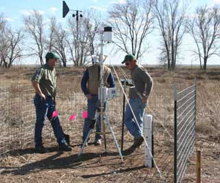 Weather and climate station is located in the low area of the dairy farm to monitor and capture rainfall. Keith Sides (L), NRCS engineer, Mark Hall, NRCS district conservationist and Seth Sowder, NRCS soil scientist set up the station in Bailey County.