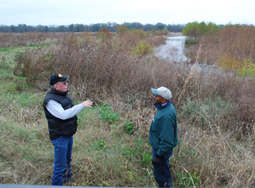 Wetland habitat surrounds Mike Darnell, left, and Steve Smith, a NRCS district conservationist. Darnell of Lamar County initially entered acreage into a permanent conservation easement agreement in the USDA�s Wetlands Reserve Program in 2001.