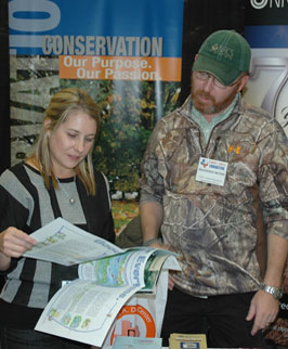 Mackenzie Moore (right) with one of several hundred teachers that visited the NRCS Booth