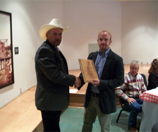Matt Feno, District Conservationist NRCS, presents Frankie Aaron with the Conservation Rancher of 2010.