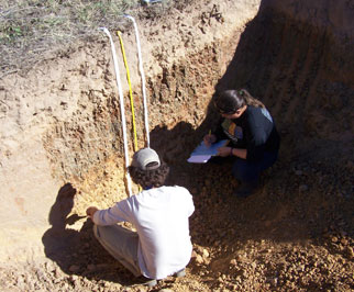 Contestants evaluate the thickness of the surface to estimate erosion class and judge the soil structure and depth. The area in the center within the tapes is designated as a