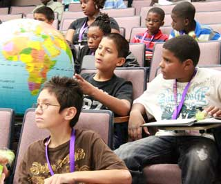 Young people search globe for GIS coordinates