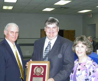 Jerry Nichols, member and chairman of the Nacogdoches County SWCD, presented the Outstanding Forestry Conservationist award to Michael Parrish and his wife Carol Parrish.