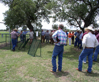 Various styles of hog traps were demonstrated to the group by local trappers.