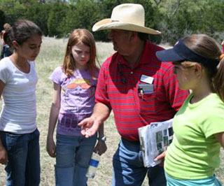 Eddie Garcia, Soil Conservationist Austin Field Office helped students with Quail CSI.