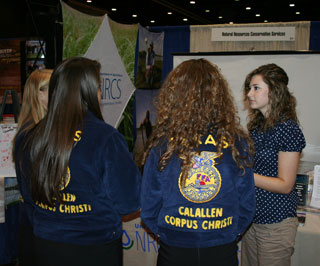 NRCS intern, Kelsey Johnson, visits with FFA students about the opportunities to participate in the Federal Women's Program high school internship program.