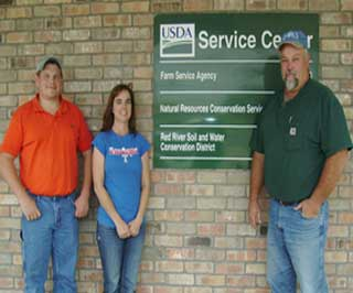 The Clarskville, Texas NRCS office team where Mr. Durrough works everyday: District Conservationist Justin Parks, SWCD Secretary Amy Hammett, and Soil Conservationist Doug Vick.