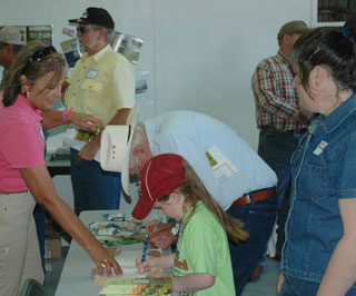 NRCS Texas State Resource Conservationist Susan Baggett helped with the registration of both young and older visitors to the 45th anniversary of the James E. �Bud� Smith Plant Materials Center, which was held on June 8-9, 2010, in Knox City, Texas.
