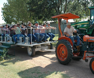 Wagons with dozens of visitors and NRCS personnel that attended the JEBS PMC 45th anniversary on June 8-9 in Knox City, Texas, were pulled by new and old conservation cadillacs (tractors) showing them the facility and various plant species grown there. The tour encompassed the new plant materials center facilities and laboratory, as well as a field tour where all the attendees had presentations delivered by NRCS personnel at field stations on the site.
