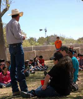 Tom Peyton, with the Sonora Natural Resources Conservation Service, speaks to over 80 elementary students during the Edwards-Plateau Soil and Water Conservation Districts annual field day.