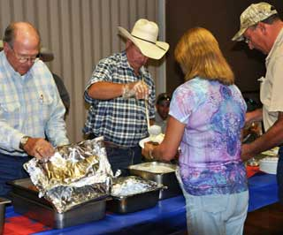 Eldorado-Divide Soil and Water Conservation District Directors, Jim Chancellor and Mike Lux (L to R) serve lunch to participants during the 1st Annual Agriculture Workshop.