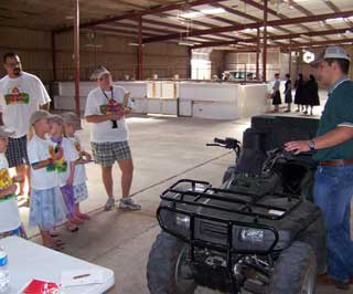 NRCS District Conservationist, Shawn Overton explains safety features and controls of the all-terrain vehicle (ATV).