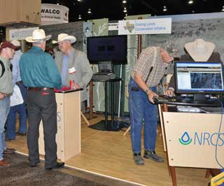 Phillip Wright, NRCS range management specialist (left photo, facing middle) and Jason Hohlt, NRCS rangeland management specialist (right photo) demonstrate Web Soil Survey to a steady stream of attendees during the two-day TSCRA trade show.