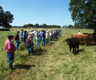 Gene Sollock of Iola, a rancher and retired director of Bedias Creek Soil & Water Conservation District, shares with attendees his ranch�s beef and forage management systems which include intensive rotational grazing and incorporating legumes into a forage system.