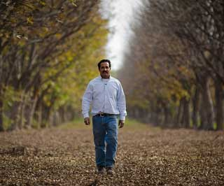 Farmer Akram Mohammad can walk through this pecan orchard at his Arrowhead Farms in Crystal City, TX, knowing he survived the exceptional 2011 drought thanks to an underground micro irrigated system that was installed with financial assistance from the NRCS� Environmental Quality Incentives Program.