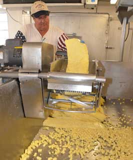Bob Stryk mills curds after the process of
