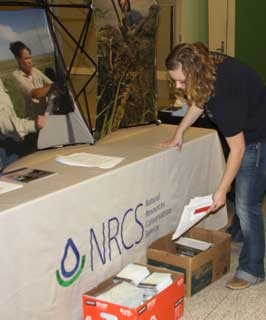 Earth Team Volunteer sets up the NRCS booth at a local career fair.