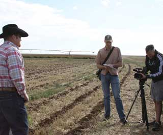 NRCS Agronomist Brandt Underwood, Lubbock, stands in one of David Ford's conservation tillage fields discussing the overall benefits of rotational cropping systems and conservation tillage practices.