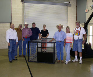 Roy Fischer, local rancher from Cherokee, Texas, was the raffle winner of the custom built hog trap.