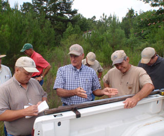 Louisiana State Soil Scientist Jerry Daigle (center) discussing soil characteristics of the Gore soil series with Senior Soil Scientist Edgar Mersiovsky (left) and MLRA 131 Project Leader Marc Bordelon (right). (left to right) Charles Guillory, Edgar Mersiovsky, Don Sabo, Jerry Daigle, Joel Bolin, Marc Bordelon, Brandon Waltman.