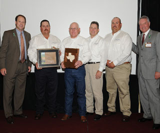 Carter Smith, (left) Texas Parks and Wildlife executive director, and Peter Holt, (far right) chairman of the Texas Parks and Wildlife Commission, present representatives of the Matador Ranch in Matador, Motley, Dickens, Cottle, Crosby and Floyd counties with the Lone Star Land Steward award for the corporation category. Covering 129,000 acres in five counties, the Matador Ranch has employed all the tools of range and wildlife management to continuously improve the long-term health and productivity of its land and water resources.