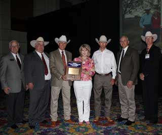 The Price family of the 77 Ranch was presented with the Outstanding Rangeland Stewardship award during the opening general session. Pictured from left to right are TSCRA First Vice President Clay Birdwell, TSCRA Second Vice President Pete Bonds, Gary Price, Sue Price, Gary Lee Price, TSCRA President Joe Parker Jr. and TSCRA Natural Resources Committee Chairman Joe Leathers. This award is co-presented each year with the Texas Section, Society for Range Management.