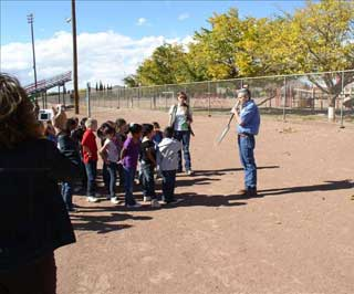 Michael Margo, NRCS-Range Management Specialist; Lyndsay Cole, High Point SWCD Administrative Assistant explain how to use a sharpshooter to the Van Horn Elementary class during a soil education field day.