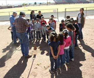 Natural Resources Conservation Service District Conservationist, Gary Fuentes, explains the purpose of a soil auger to the Van Horn Elementary 1st grade class.
