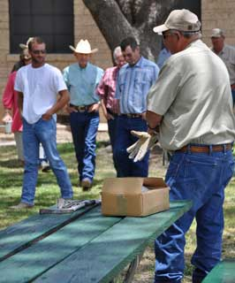 Pete Bland, with Texas Wildlife Services, prepares to show workshop participants how to safely use both M44�s and Livestock Protection Collars during the 1st Annual Agriculture Workshop.
