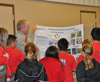Dr. Mark Muegge with the Texas AgriLife Extension Service explains beneficial and harmful insects to a group of Garden City 3rd grade students.