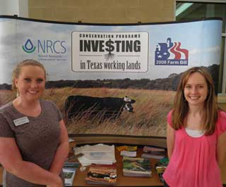 (L to R) Anna Stone, NRCS soil conservationist and Sara Gilmer, NRCS soil scientist promotes conservation programs at the Northeast Texas Community College (NTCC) Agriculture Expo in Mt. Pleasant.