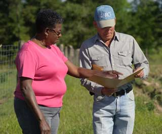 Kather Woods reviews her conservation plan with Houston County NRCS District Conservationist Stan Murff.