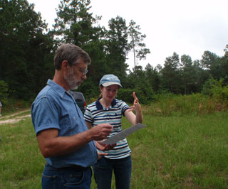 MLRA 133B Supervisor Alan Peer, and Soil Scientist Sara Russell comparing soil characteristics to the official soil series description.