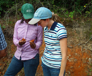 Sara Russell (right) and Tiffany Roberson (left) , Soil Scientists, examining clay films on soil.