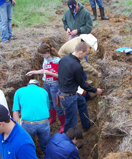 Contestants determining soil texture, permeability of the subsoil, surface thickness and depth of the soil. (Photo by D. Brezina)