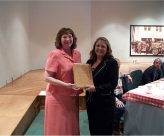 Connie Easley receives the Outstanding Woman in Agriculture award from Teresa Griffin, District Technician Panola SWCD