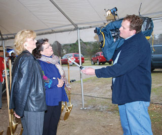 Jane Ray, right, is interviewed by ABC news affiliate KTBS before the groundbreaking ceremony began. The event was covered by ABC and CBS television affiliates, along with local AM radio station KGAS.
