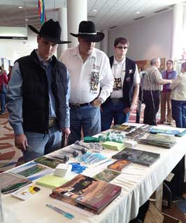Visitors gather information on NRCS at the agency's booth during the recent Ranching & Wildlife Expo in Houston.