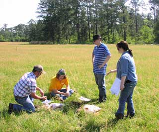 Students and an instructor discuss land judging after the contest.
