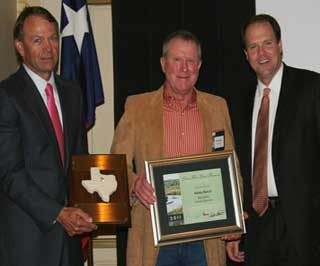 Rob Hailey, center, owner of the 2,560-acre ranch near Abilene, Texas, receives the 2011 Lone Star Land Steward Award from TPWD Commissioner Ralph Huggins, left, and TPWD Executive Director Carter Smith, right, during the award ceremony held on May 25 in Austin. (Photo Credit: Ricky Linex, USDA-NRCS)