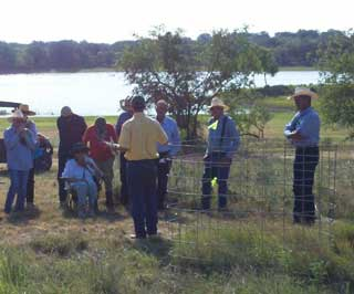 Rafael Aldrich, NRCS rangeland management specialist in Graham, demonstrates how to set up and use a utilization cage to increase efficiency of grazing management decisions.