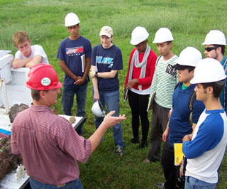 on Wiedenfeld, soil scientist at Rosenberg, describing soil features to Rice University students.