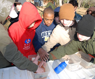 The scouts also learned the difference between sand, silt and clay soils using soil samples.