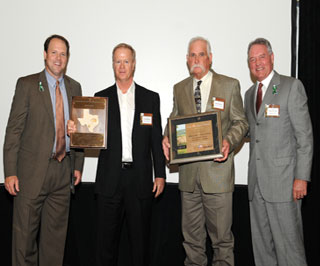 Carter Smith, (left) Texas Parks and Wildlife executive director, and Peter Holt, (far right) chairman of the Texas Parks and Wildlife Commission, present representatives of the Matador Ranch with the Lone Star Land Steward award for the South Texas Plains ecoregion. Killam and Kitner have transformed the landscape of the ranch from an abused rangeland to a healthy ecosystem with flourishing wildlife populations, while maintaining profitability.