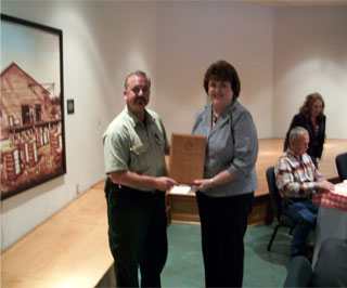 Phillip Gates presents Kathy English with the Outstanding Woodland Conservationist.