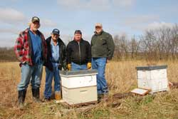 Joining efforts to build the bee population and crop production in Nodaway County are (from left) Kevin Helzer, Byron Miller, Mike Burch and Ray Werner.
