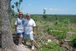 Hosea and Debbie Lawrence at a glade restoration on their acreage in Ozark County.