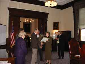 Henry Mixter receiving an award from NH Governor Shaheen.